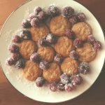Cookies on a white plate with frozen cherries