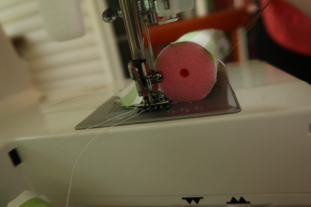 fabric covered pink sponge roller on sewing machine